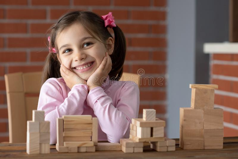 Happy Smiling Child Girl Playing With Wooden Toys royalty free stock photos