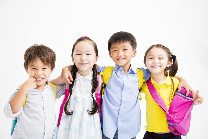 Happy smiling children hugging together royalty free stock images