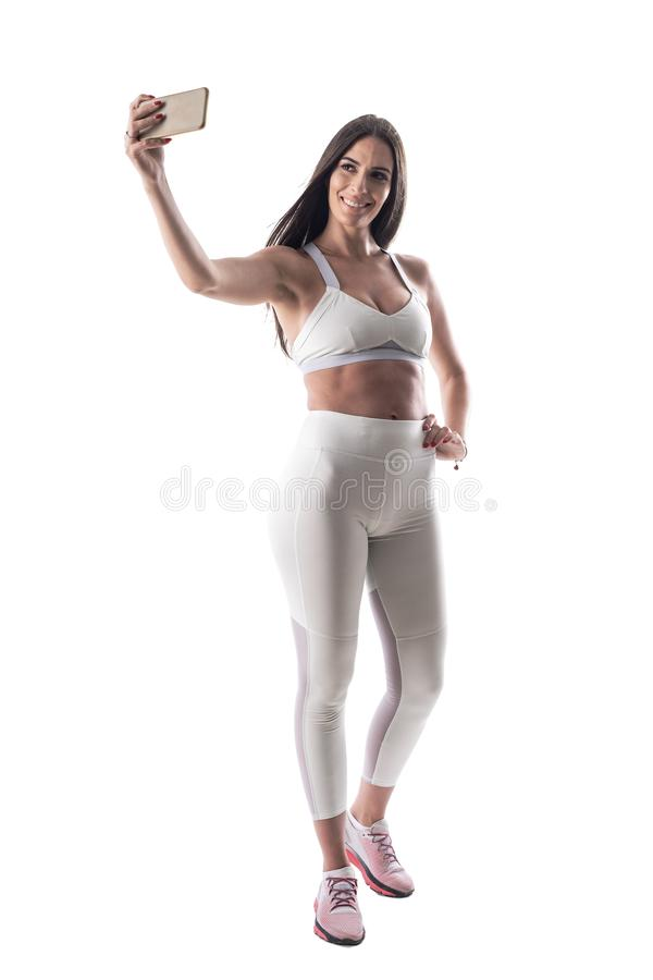 Happy smiling confident fitness woman taking selfie after gym exercises royalty free stock photo