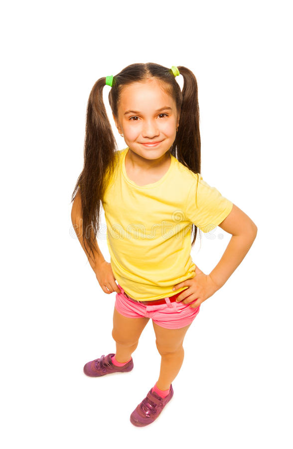 Happy smiling confident little girl in yellow stock images