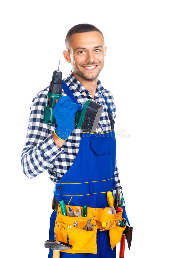 Happy smiling construction worker with drill and tool belt. Isolated on white background stock image