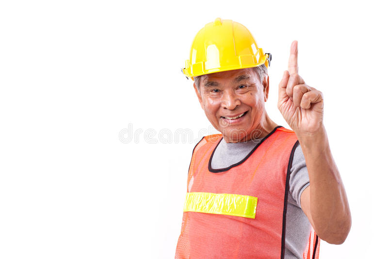 Happy, smiling construction worker showing 1 finger gesture stock photography