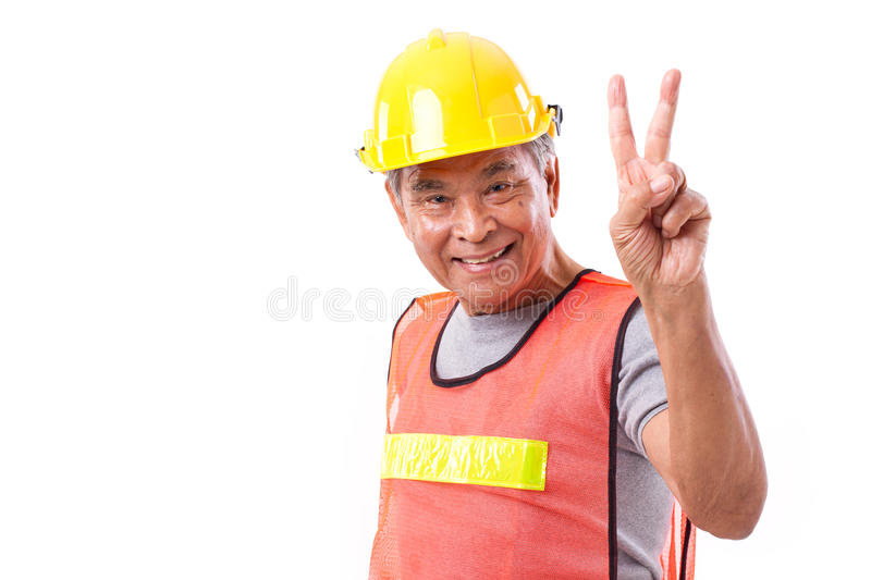Happy, smiling construction worker showing 2 fingers gesture, vi royalty free stock photo
