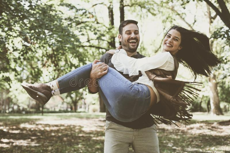 Happy smiling couple enjoying together in park. stock photo