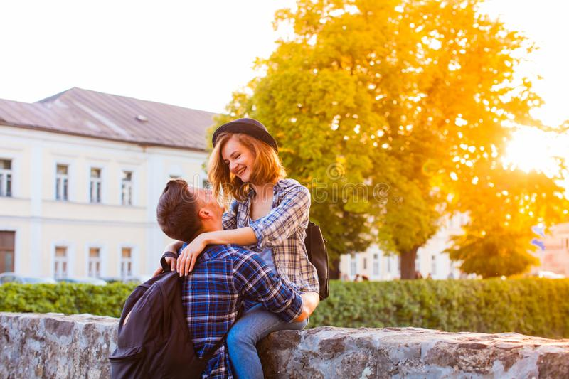 Happy smiling couple of young stylish travellers stock images