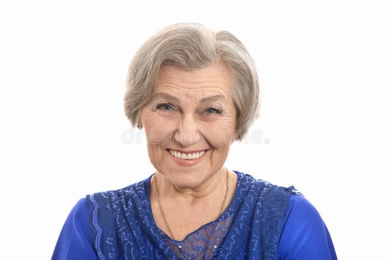 Happy smiling elder woman in elegant dress stock photo