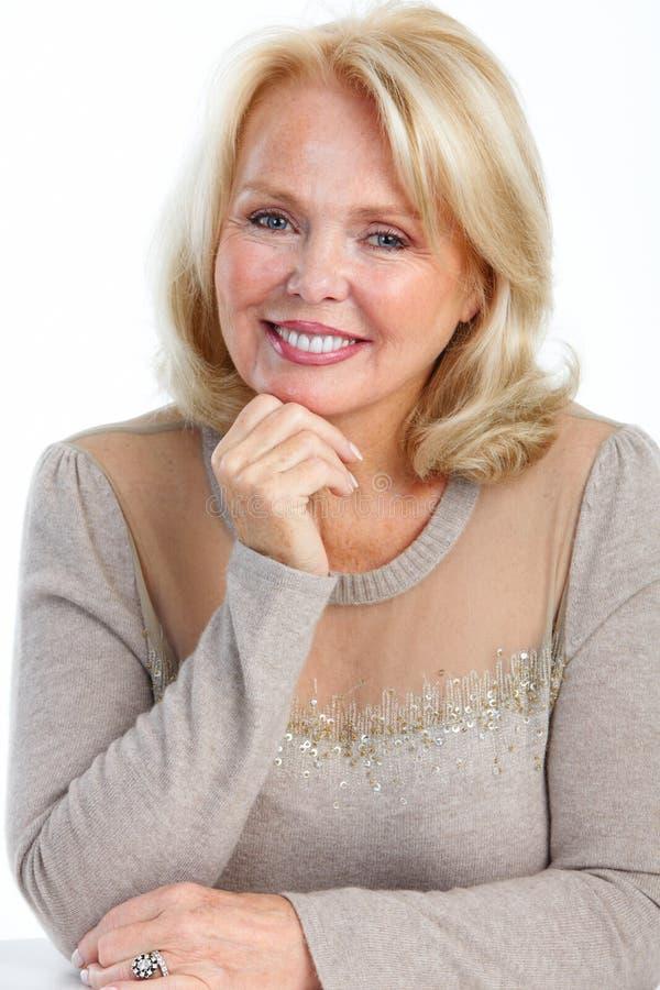 Smiling elderly senior woman. Happy smiling elderly senior woman on white background royalty free stock images