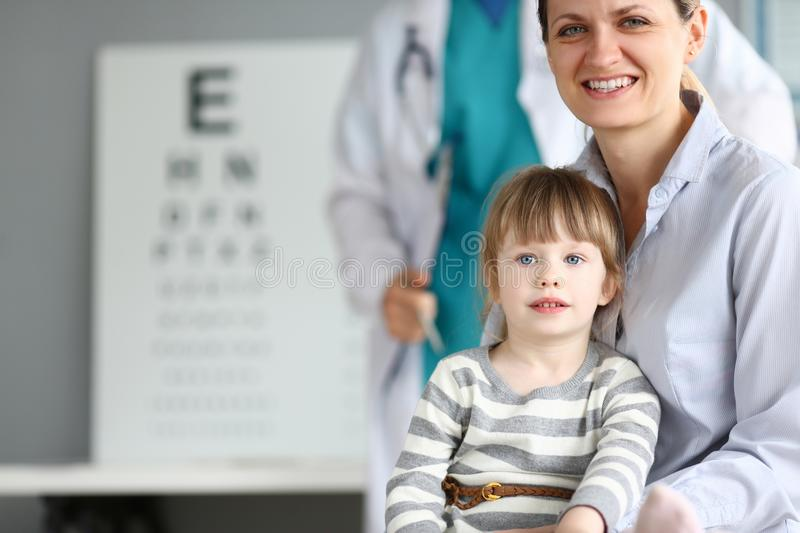 Happy smiling family at child doctor office stock photos