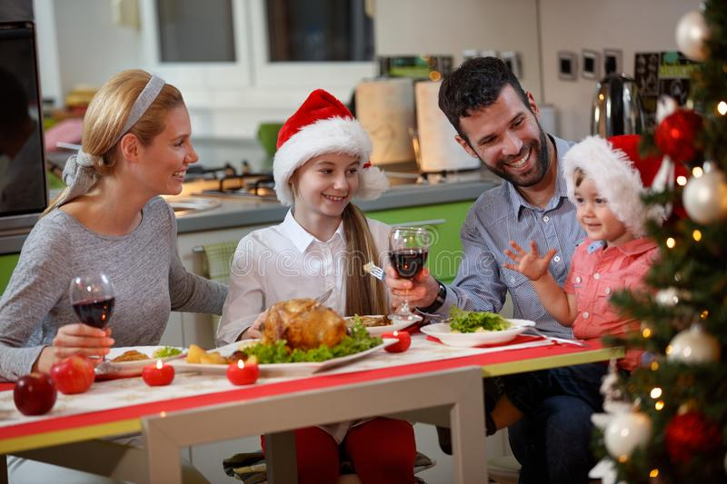 Happy Family enjoying eating traditional Christmas dinner royalty free stock photography