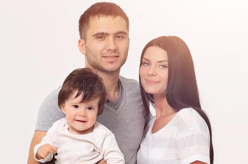 Happy smiling family isolated over white stock images