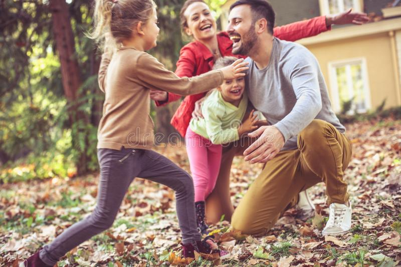 Happy smiling family running and playing at backyard. royalty free stock images