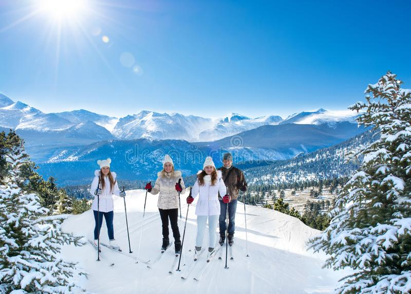 Happy smiling family skiing on winter vacation. royalty free stock photos