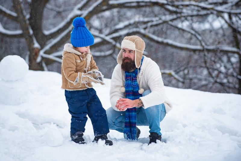 Happy smiling family on sunny winter day. Winter father and son. Enjoying nature wintertime. The morning before. Christmas. Merry Christmas and Happy new year royalty free stock images