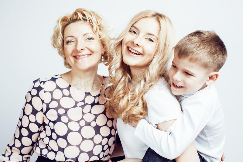 Happy smiling family together posing cheerful on white background, lifestyle people concept, mother with son and teenage stock images