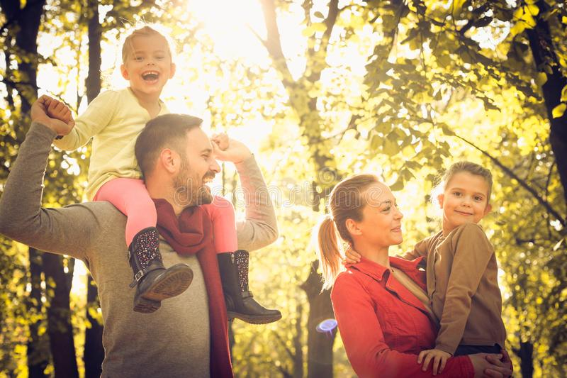 Happy smiling family walking trough nature, royalty free stock photography