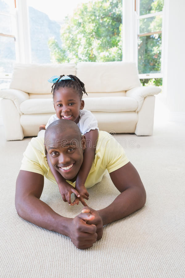 Happy smiling father with her daughter royalty free stock photo