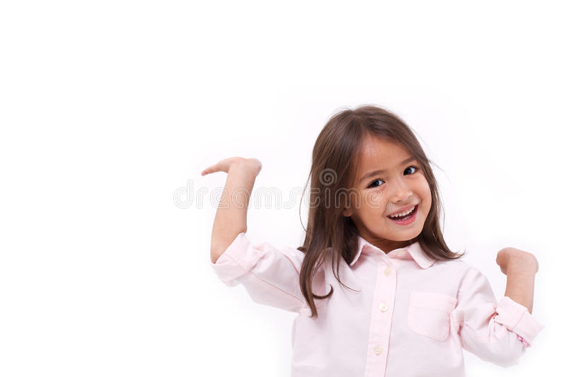 Happy, smiling female asian caucasian kid playing royalty free stock photo
