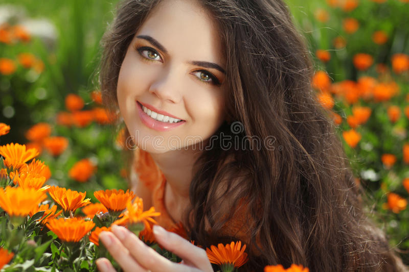 Happy smiling girl. Beautiful Romantic Brunette female Outdoors royalty free stock images