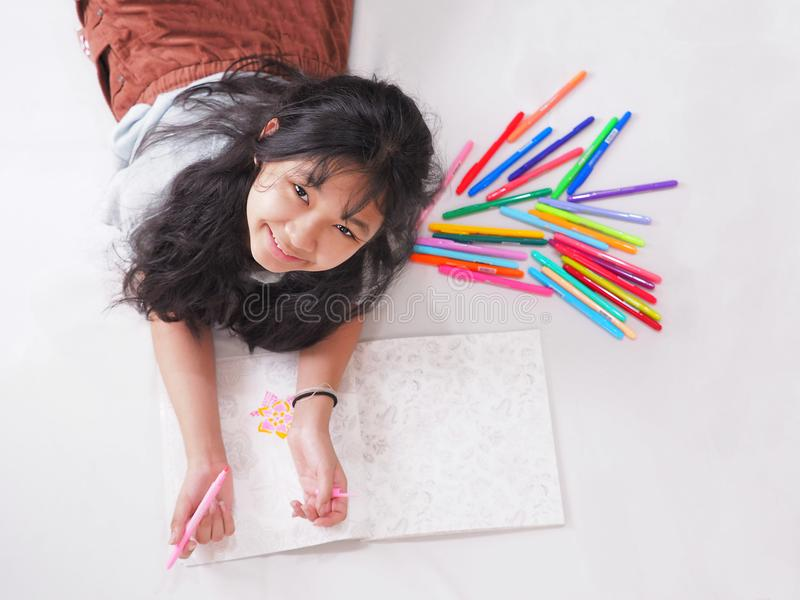 happy smiling girl colouring on peper with variety color pen fall all shade royalty free stock photos