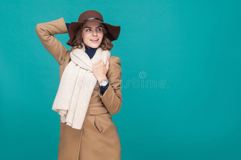 Happy smiling girl dressed in autumn coat, hat and scarf. royalty free stock photography