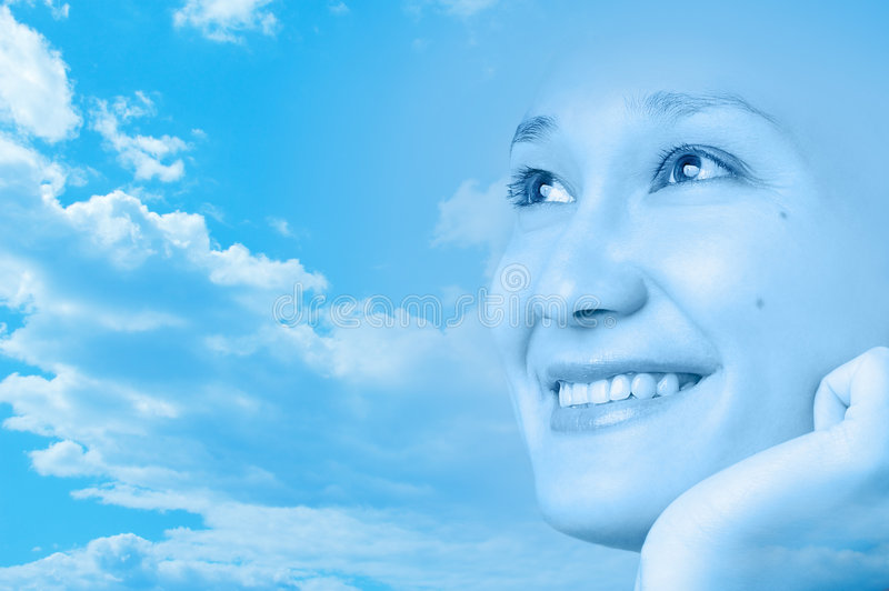 Happy smiling girl face artistic design. Beautiful young happy smiling woman on artistic sky blue background summer season design royalty free stock images
