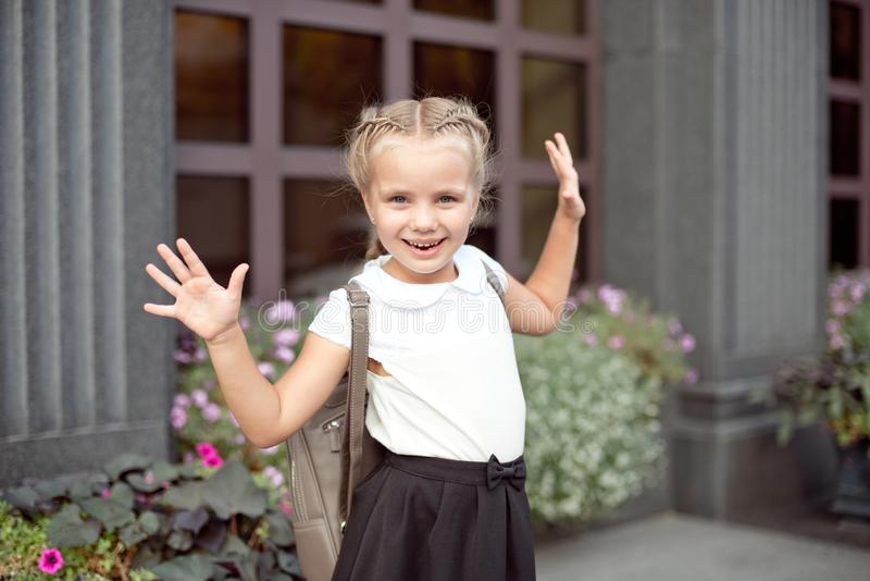 Happy smiling girl is going to school for the first time with bag go to elementary school stock photography