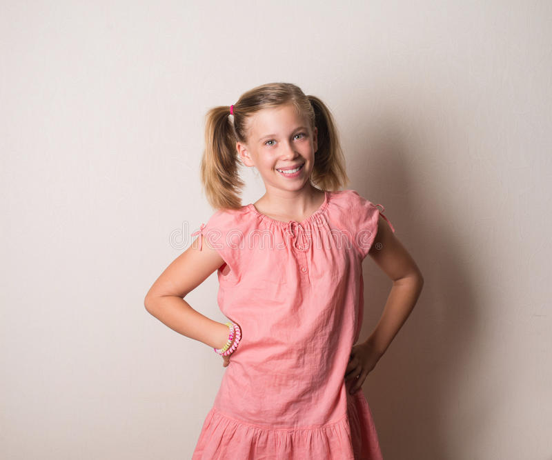 Happy smiling girl in pink dress portrait royalty free stock image