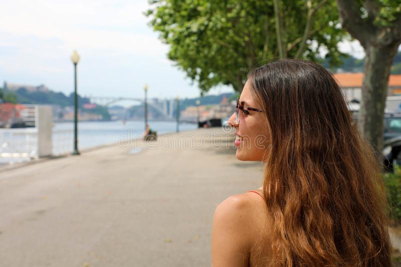 Happy smiling girl in Porto City, Portugal. Beautiful young tourist woman traveling in Europe stock images