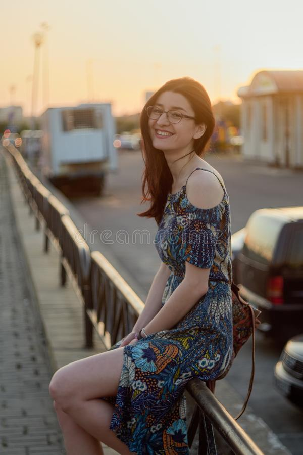 Happy smiling girl. Portrait of a caucasian girl at sunset. royalty free stock photography
