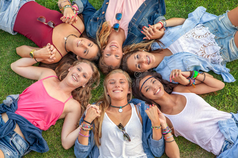 Happy smiling group of diverse girls stock image