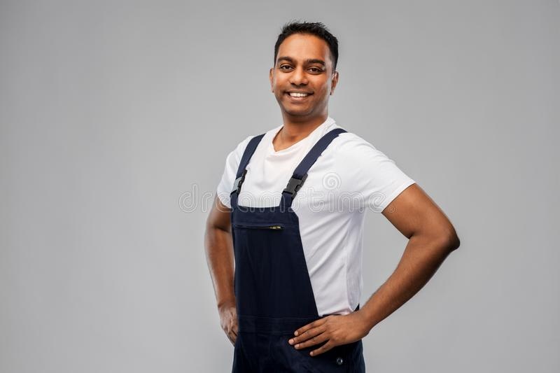 Happy smiling indian worker or builder royalty free stock photos