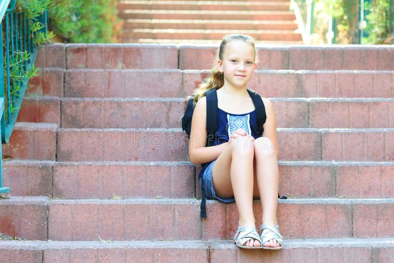 Happy smiling girl Back to school. royalty free stock images