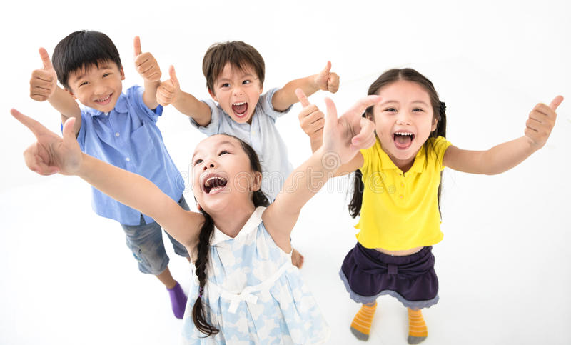 Happy smiling kids with thumb up stock photos