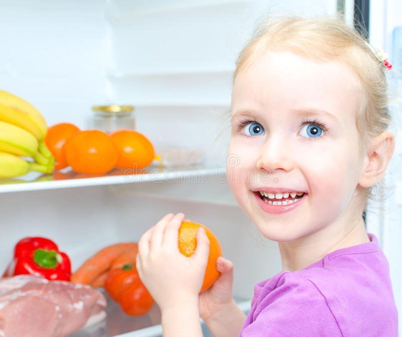 Download Happy Smiling Little Girl Holding Orange Stock Photo - Image of cook, eggs: 29091314