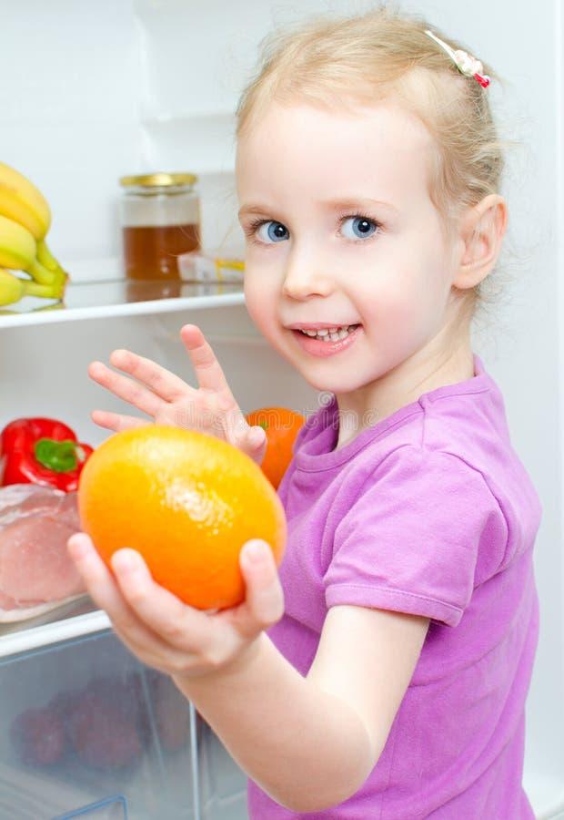 Download Happy Smiling Little Girl Holding Orange Royalty Free Stock Image - Image: 29091316