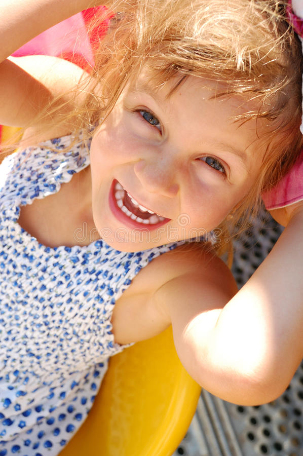 Happy smiling little girl outdoor. Adorable little laughing girl having fun outdoor royalty free stock photo