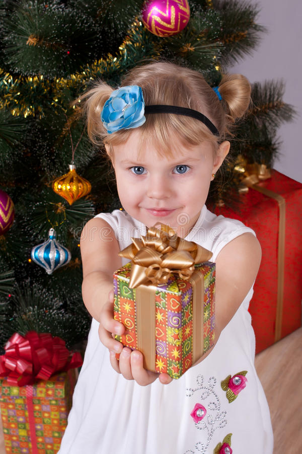 Free Happy Smiling Little Girl With Gifts Royalty Free Stock Photos - 28194668