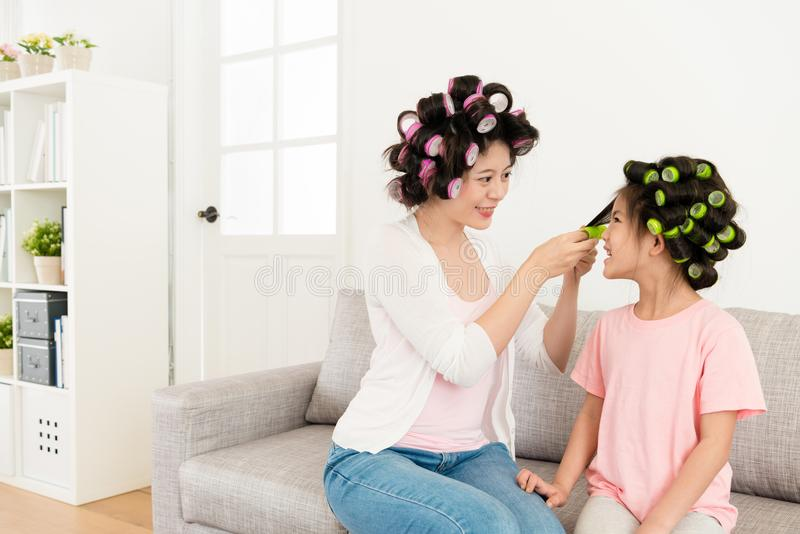Happy smiling little girl with young beauty mother stock images