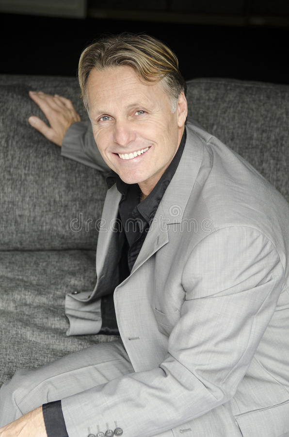 happy smiling man in grey suit royalty free stock photo