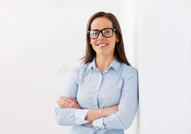 Happy smiling middle aged woman in glasses royalty free stock photos
