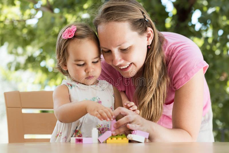 Happy Smiling Mother and Baby Daughter Having Fun royalty free stock photo