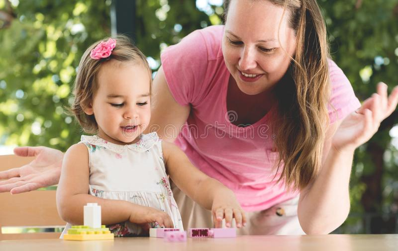 Happy Smiling Mother and Baby Daughter Having Fun stock image