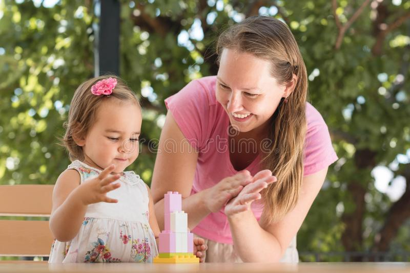 Happy Smiling Mother and Baby Daughter Having Fun royalty free stock photography