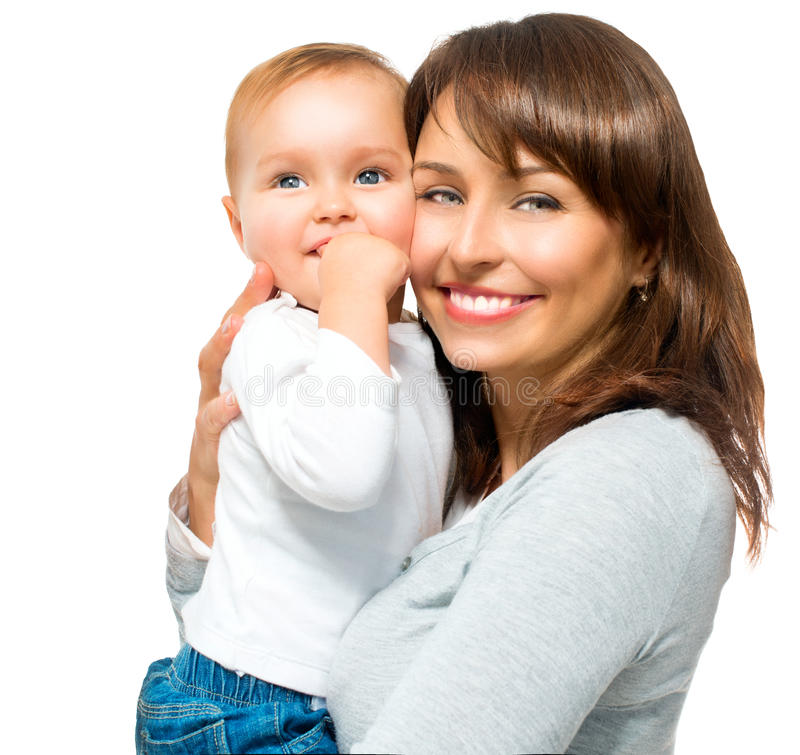 Happy Smiling Mother and Baby. Kissing and hugging at Home royalty free stock photos