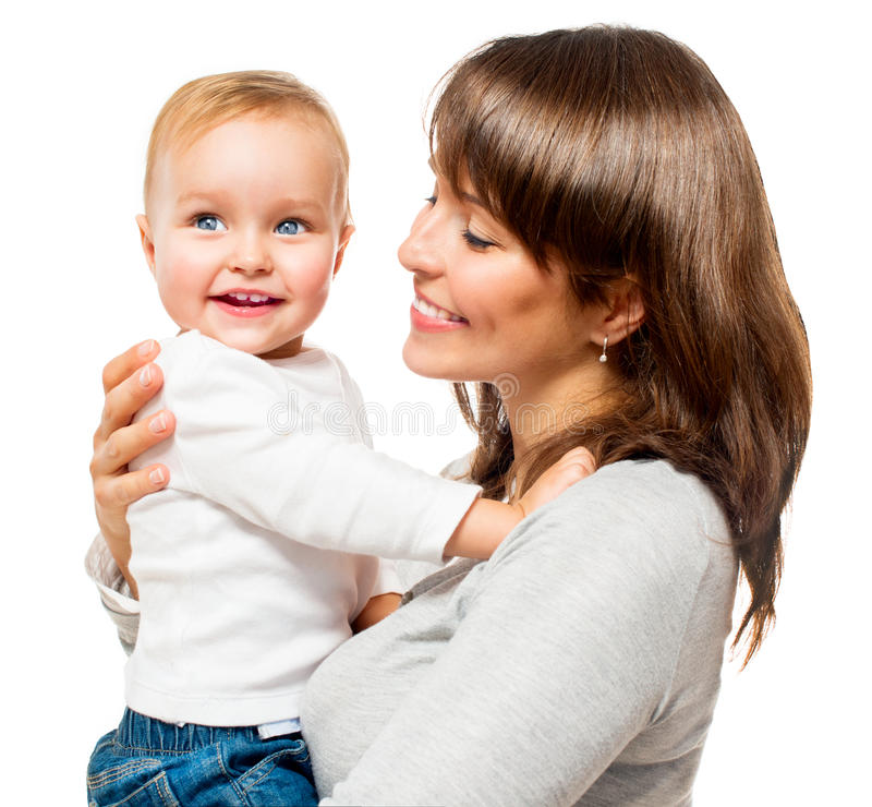 Happy Smiling Mother and Baby. Kissing and hugging at Home royalty free stock photography