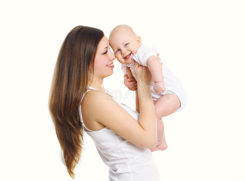 Happy smiling mother and baby playing on white background stock image