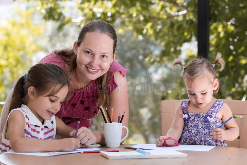 Happy Smiling Mother And Child Daughters Having Fun stock photo