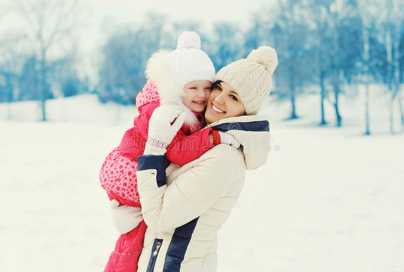 Happy smiling mother and child together in winter stock photo