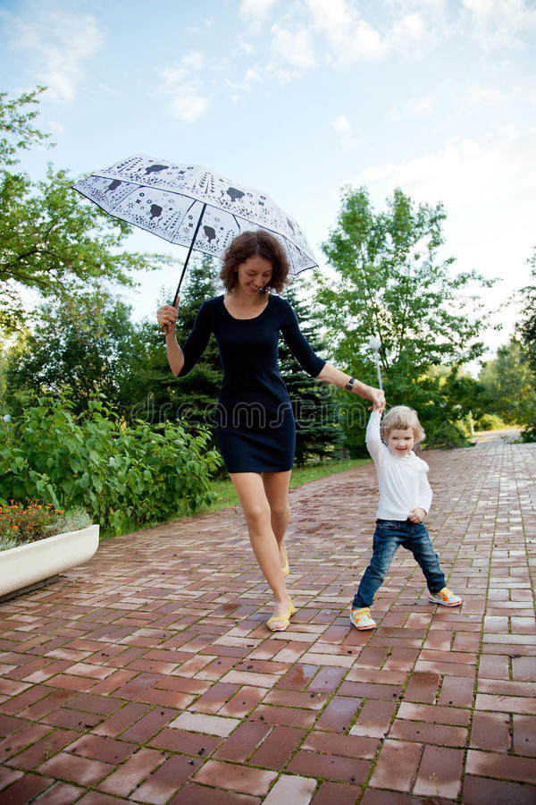 Happy smiling mother and daughter with umbrella stock photo