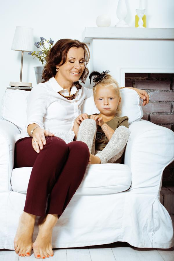 Happy smiling mother with little cute daughter at home interior, casual look modern real family, lifestyle people stock image